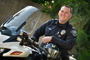 "Fullerton PD Motor Officer Kyle Baas on his Honda ST1300 police motorcycle. ""It's the best-kept secret of the police department,"" Baas says. ""I get paid to ride a motorcycle every day."" Photo by Steven Georges/Behind the Badge OC"
